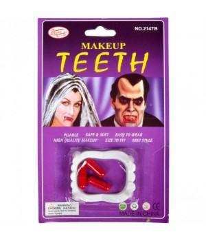 Зубы с кровью.