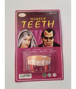 Прикол зубы с клыками.